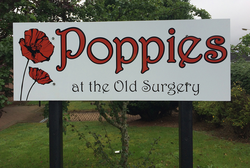 poppies-signage
